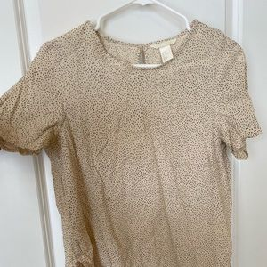 Cream top with black polka dots. H and M